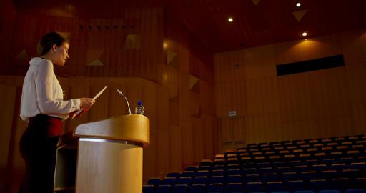 Young Caucasian businesswoman practicing speech in empty auditorium 4k Live Action