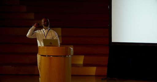 Mature African american businessman speaking at podium in auditorium 4k Live Action