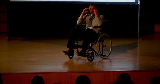 Mature Caucasian disabled businessman speaking in business seminar in auditorium 4k Live Action