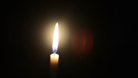 Candles light in dark background video HD.Light in darkness as light for life concept.Candle for Live Action
