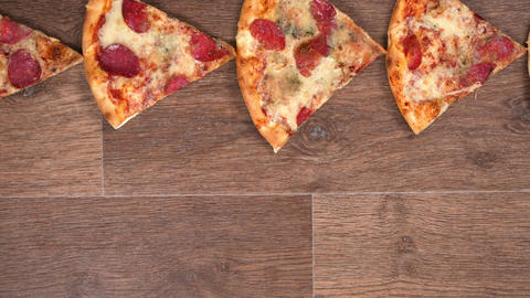 Pieces of pizza passing in the frame of each other, stop motion animation Footage