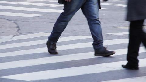 Pedestrian Crossing The Street. Pan Shot GIF