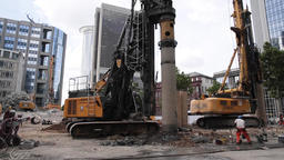 Drilling Excavator Machines at Work on Construction Site Live Action
