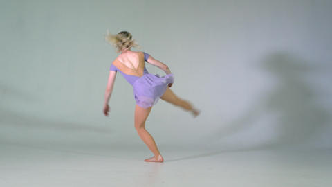 4k - Graceful ballerina dancing in studio on white background Live Action