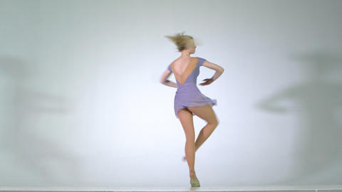 4k - A yound blonde girl spinning ballet pirouette isolated Live Action