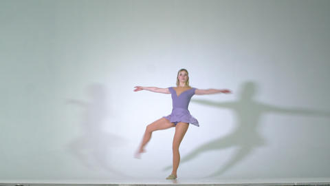 4k - Attractive young woman spinning ballet pirouette isolated Footage
