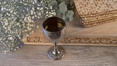 Pesach Passover symbols of great Jewish holiday. Traditional matzah and wine Live Action
