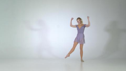 4k - Flexible dancer smiling and making leg extension in studio Live Action