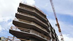 Construction Crane above Building Under Construction Live Action