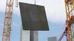 Construction Panel Held in Midair by Construction Crane Live Action