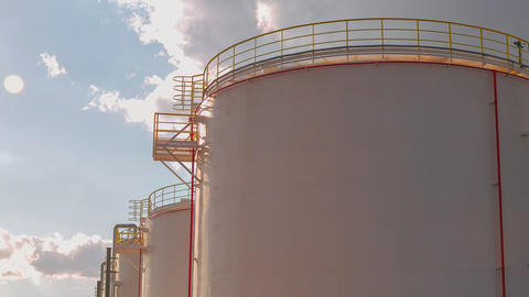 timelapse gas reservoirs with service grounds against sky Live Action