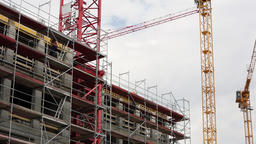 Scaffolding and Construction Crane at Building Construction Site Live Action
