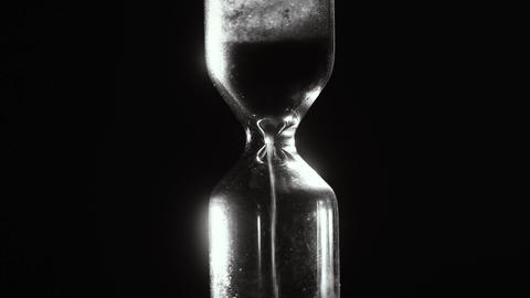 Hourglass. Black and white. Countdown. Time laps. 4k Footage