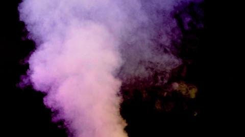 Abundant cloud of smoke emerging on black background Footage