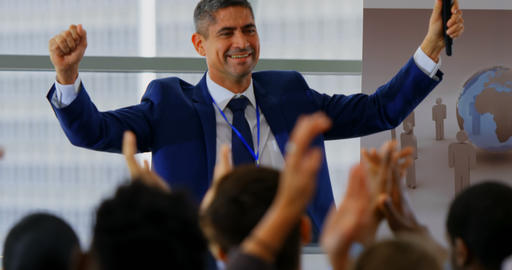 Businessman celebrating his success in the business seminar 4k Live Action
