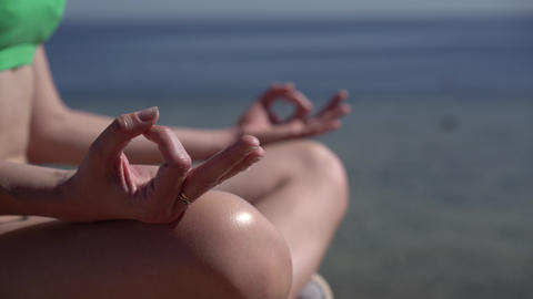 Close up shot of the practice yoga on the beach of the ocean Footage