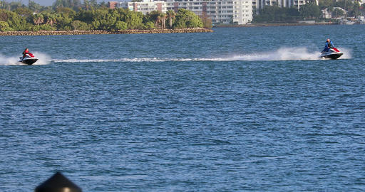 Men Riding Jet Ski At A High Speed In Miami Bay Live Action