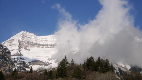 Timelapse shot of clouds blowing over Mt. Timpanogos, UT Footage
