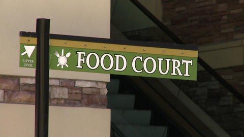 Food court sign with escalator in background Live Action