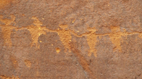 Panning close-up shot of ancient drawings on rocks in Utah Footage