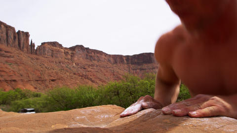 Close-up shot of a rock climber as he reaches the top of... Stock Video Footage