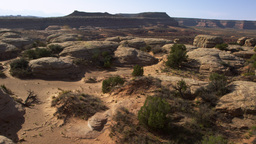 Aerial shot of rock formations at the Moab Desert with lens flare Footage