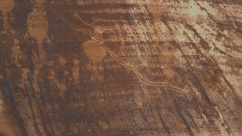 Panning shot of ancient drawings on rocks Footage