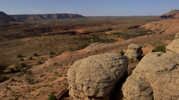 Flying over rock formations at the Moab Desert in Utah Footage