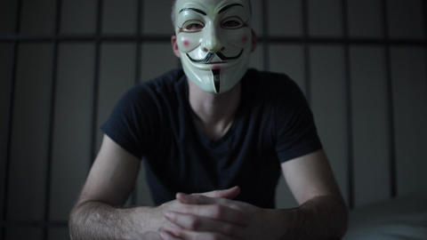 Anonymous hacker in prison glares at camera Footage