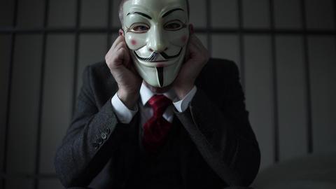 Scene of Anonymous hacker prisoner Live Action