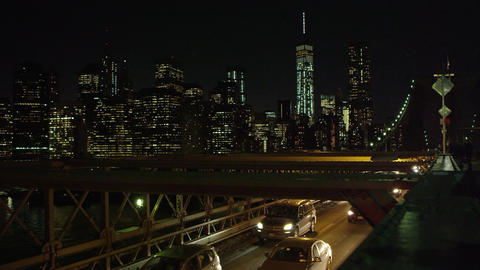 Slow motion static shot of traffic on the Brooklyn Bridge Footage