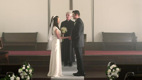 Newlywed couple kisses, turns, and walks down the aisle Footage