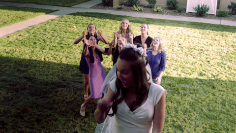 Slow-motion bride throwing bouquet of flowers Footage