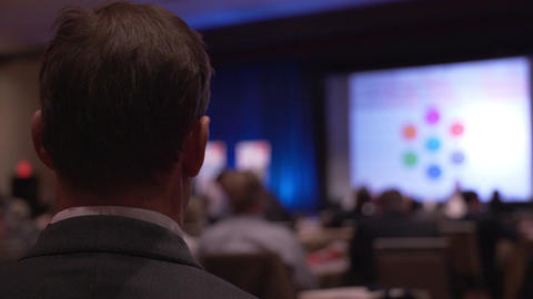 Man listens at a conference Footage