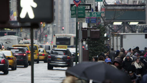 Slow motion view of a busy street with people and vehicles in downtown Manhattan Footage