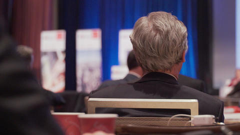 People listen at a conference Footage
