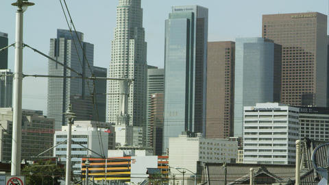 Zoomed slow motion pan of the sky scrapers in Los Angeles Live Action