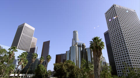 Upward side pan of sky scrapers in Los Angeles Live Action