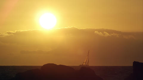 Static view of sailboat on the horizon at sunset Live Action