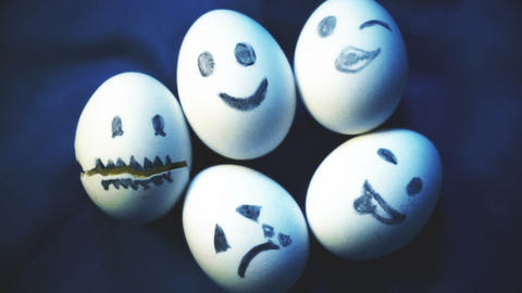 Pile of eggs with different emotions, variety, individuality Footage