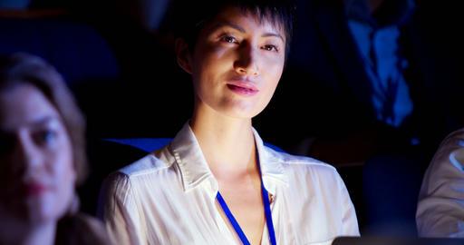Asian businesswoman attending business seminar in auditorium 4k Live Action