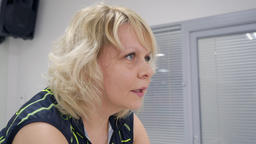 Close up face adult woman training on indoor bike at cycling class in sport club Footage