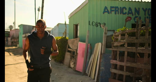 African American male boxer exercising near beach in sunshine 4k Live Action