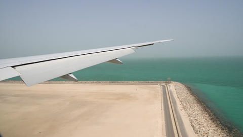 the plane lands at the airport. view of the wing from the plane window. high Live Action