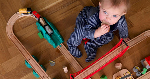 Child playing with wooden train top view Footage