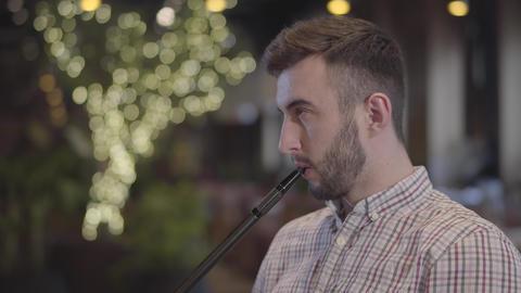 Portrait of handsome man enjoying hookah in modern restaurant or cafe. Handsome Live Action