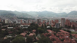 Backwards flying drone aerial view of the city of Medellin in Colombia showing the cityscape and Footage