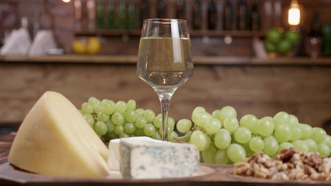 A glass of white wine with grapes and a variety of cheeses ライブ動画