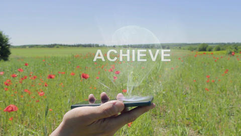 Hologram of Achieve on a smartphone Live Action