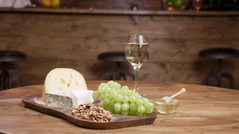 Artistic food composition of cheeses, grapes and wine ライブ動画